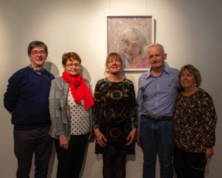 No Repro Fee: Cork County Council Host an exhibition 'Memory is Grey' in Library HQ by artist Gillian Cussen which explores memory loss. Pictured in front of the portrait of Ethna Dalton, Kinsale, are artist Gillian Cussen, Ethna's carer Declan Corrigan, and her family, Fidelma Dalton, Ciarán Dalton & Mary Dalton